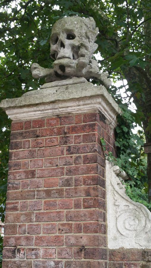Skull & crossed bones on the gate of St. Nicholas Church, Deptford, London