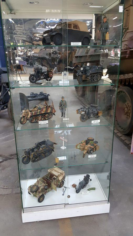 Glass cabinet with model vehicles