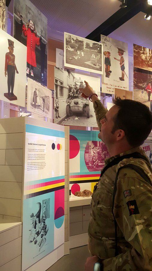 Soldier pointing in the Society Gallery photo at the National Army Museum