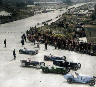 Colourized photo of the cars and race officials on the track at the 1926 British Grand Prix