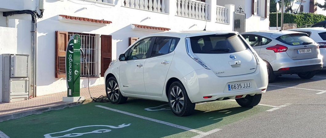 Nissan Leaf electric car being charged at a charging station