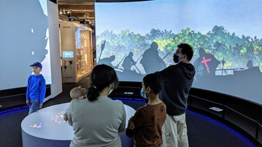 A family watches the 360 degree Battle of Agincourt experience