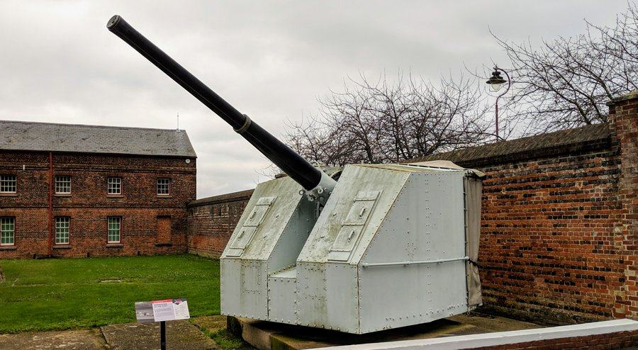 Large grey-painted naval gun turret