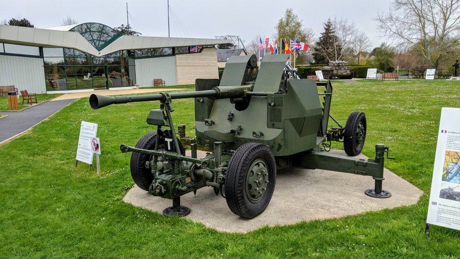 Wheeled anti aircraft gun displayed by the grass on a concrete plinth