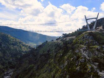 Thin suspension bridge crosses a steep ravine
