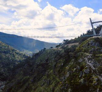 Thin suspension bridge crosses a steep ravine