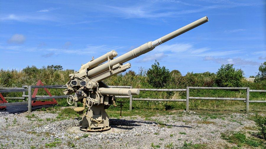Brown painted anti aircraft gun pointed skyward