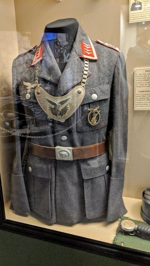 German tunic with insignia and a standard bearer necklace