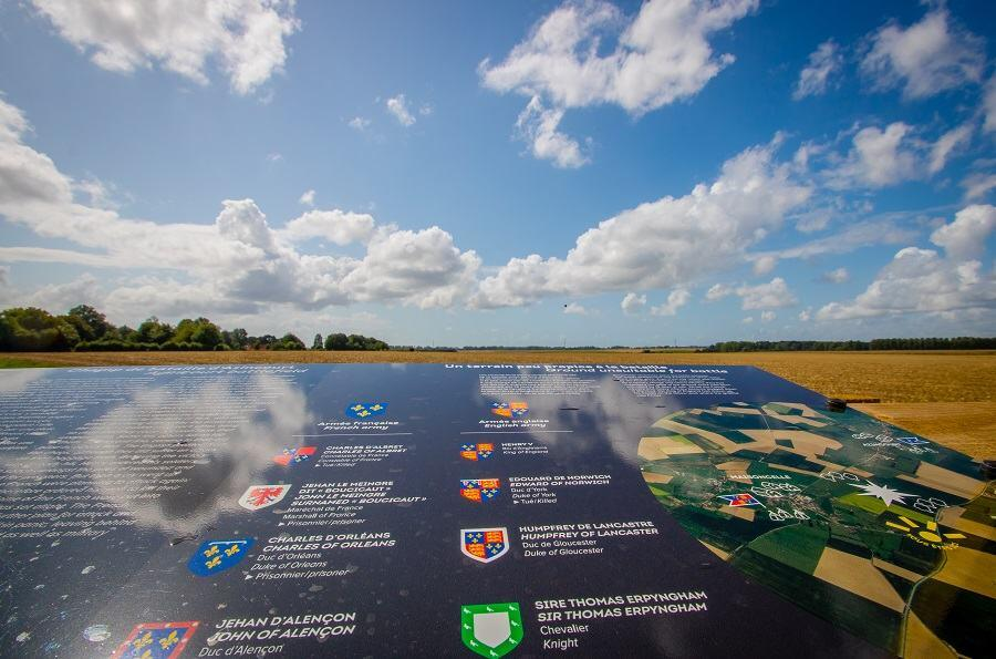 View over the Agincourt battlefield on a clear bright day with a map on a plinth in the foreground