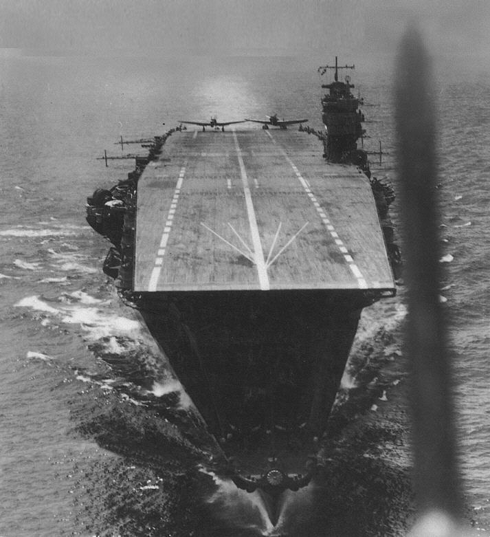 B&W photo of the Akagi from a plane that has just been launched