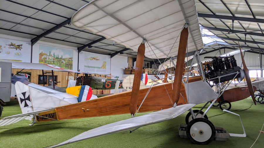 WWI biplane with a brown fuselage. The Albatross C2 is displayed at the Salis Flying Museum.