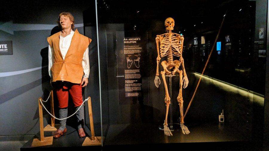 A skeleton stands next to a recreation of the actual man