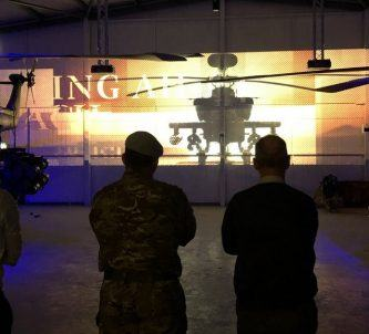 Army staff looking at a new display