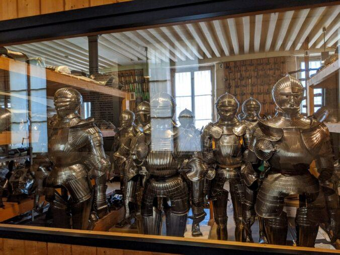 Dozens of suits of silver steel armour