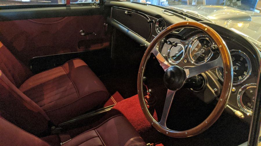 Red material and wooden trim in interior of Aston Martin DB3