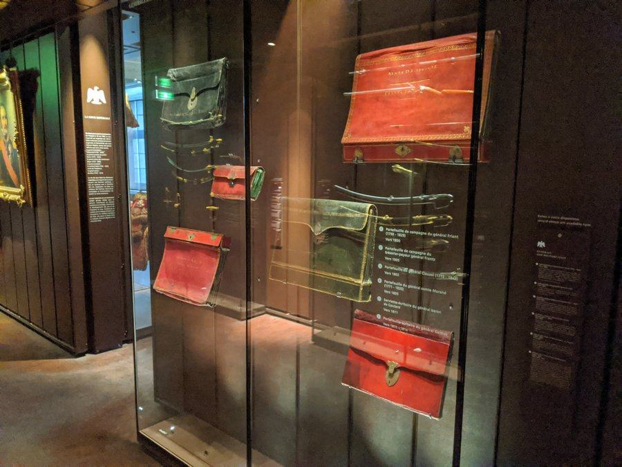 Faded red leather briefcases in a display cabinet
