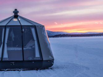 Igloo accommodation on an icefield at sunset