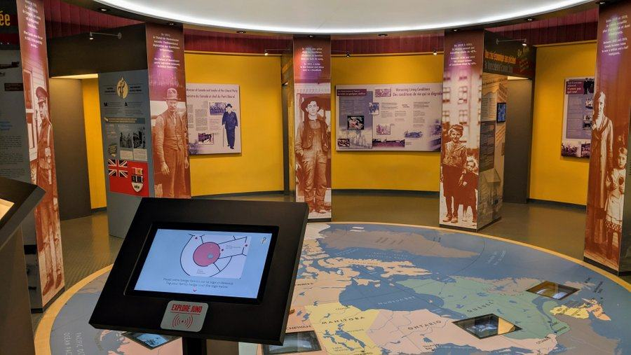 A galley with an interactive map on the floor and displays on the walls