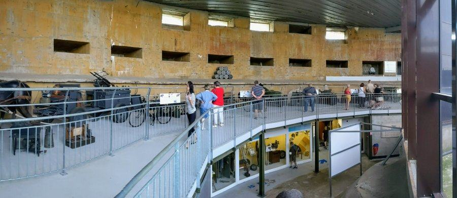 Mezzanine level in the casement with visitors looking at the exhibits