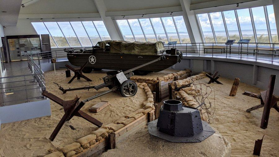 A view of the semicircular gallery with a diorama of beach defenses and windows looking out over the beach they defended