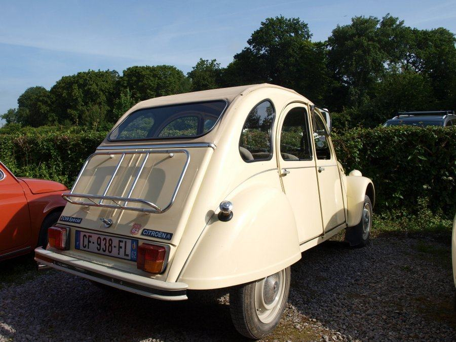 A light brown Citroen 2CV car