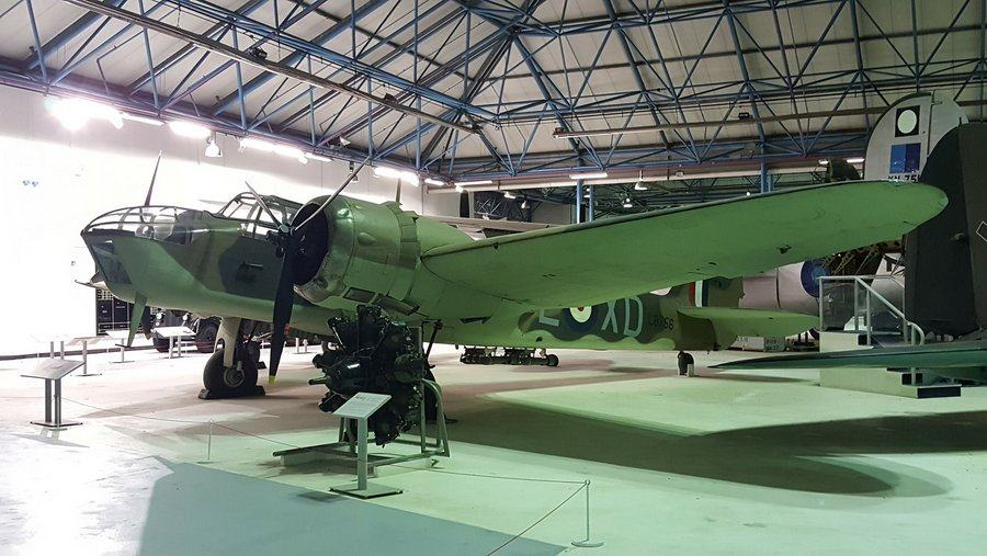 Twin-engined British bomber bathed in a green light