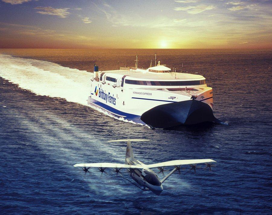 A seaglider whizzing past a Brittany Ferries fast ferry at sunsetat