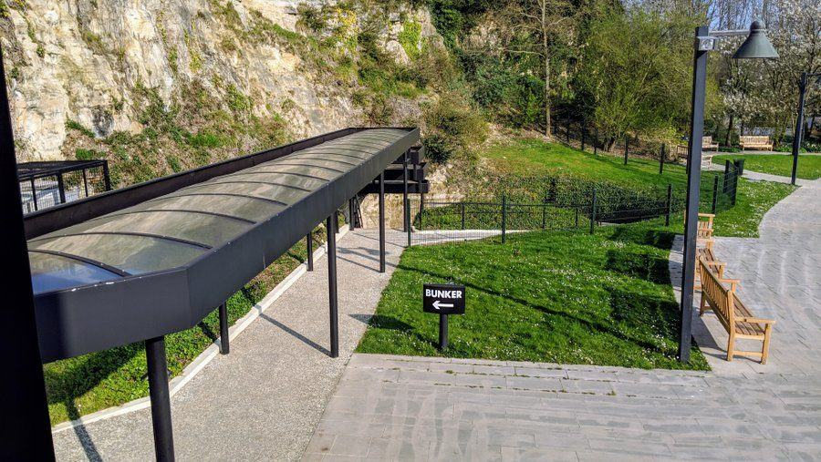 View along the covered walkway at the bottom of the cliff, towards the bunker entrance