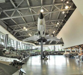 Museum gallery with tanks & a jet fighter