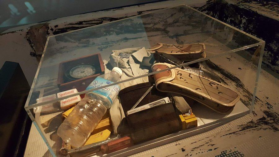 Collection of water bottles, ammunition, tools on a Somali pirate skiff