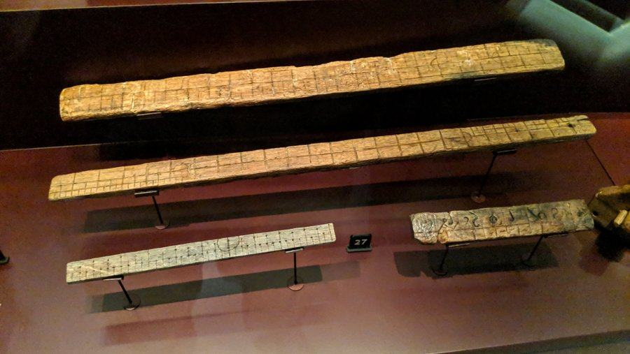Four wooden rulers