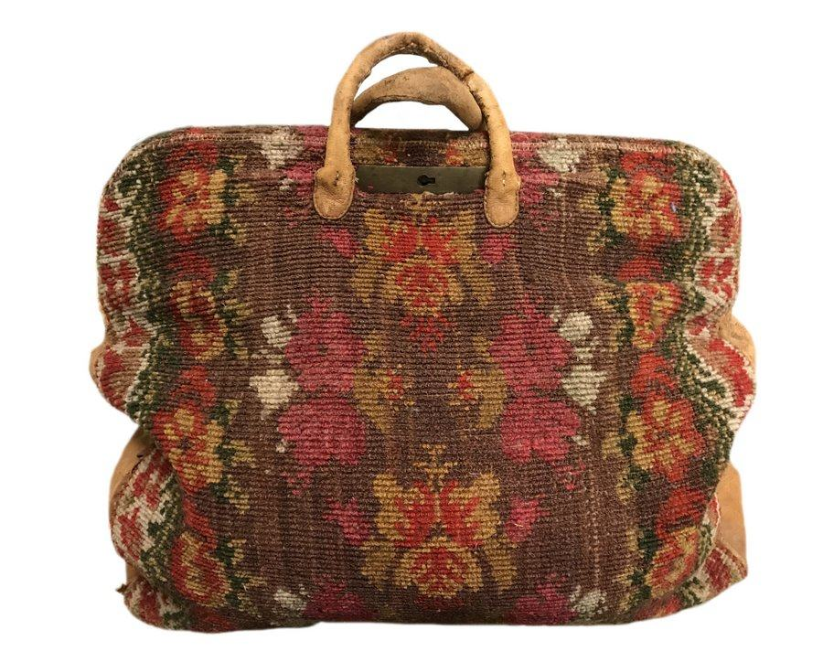 A colourful but old carpet bag