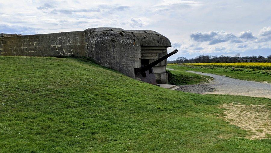 Side view of a concrete casement with a gun pointing skyward