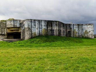 A concrete gun emplacement in a green field