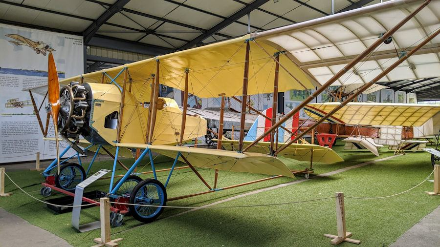 Early biplane at the Salis Flying Museum with spars instead of a fuselage