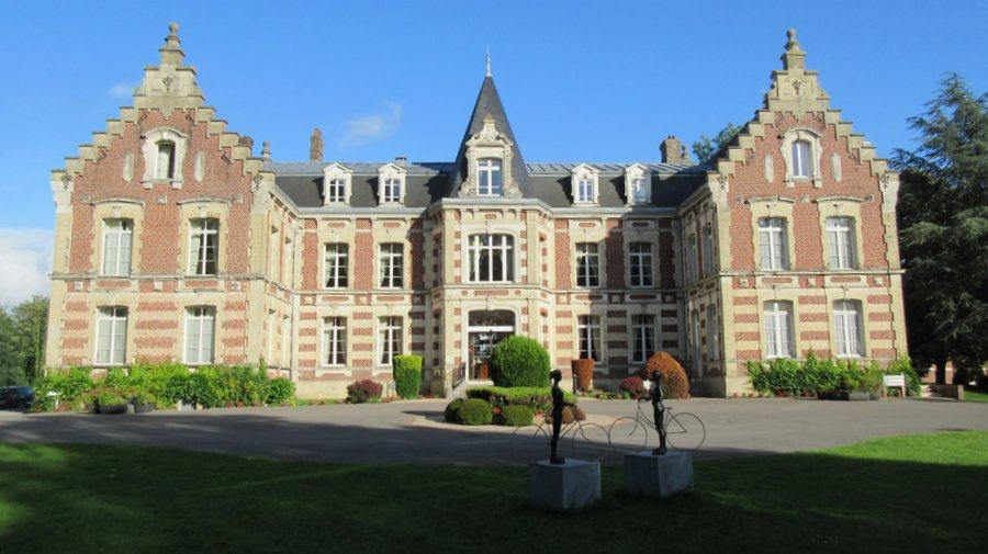 View of the front of Chateau Tilque bathed in sunlight