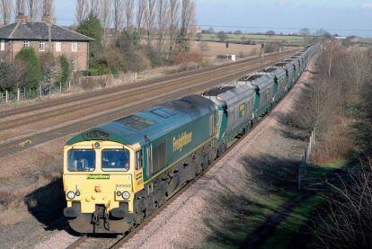 A British Rail diesel hauls a long train of coal trucks