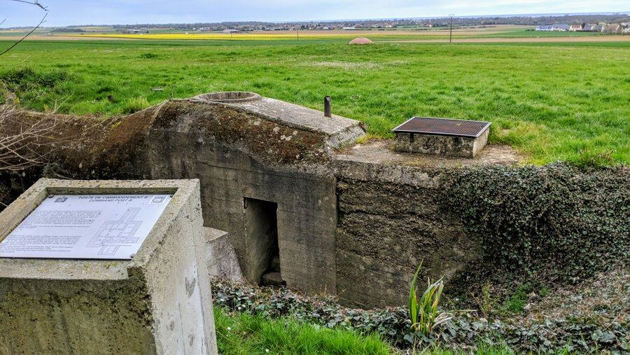 Sunken entrance to another command bunker, buried under grass.