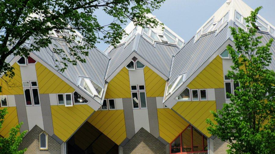 Bright yellow box shaped houses balanced on their corners