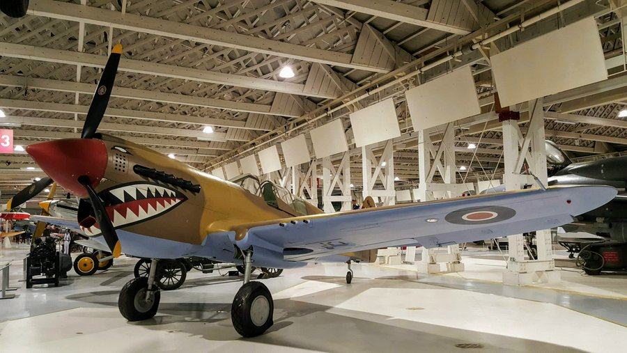 Brown camouflaged WW2 Kittyhawk fighter with sharks mouth