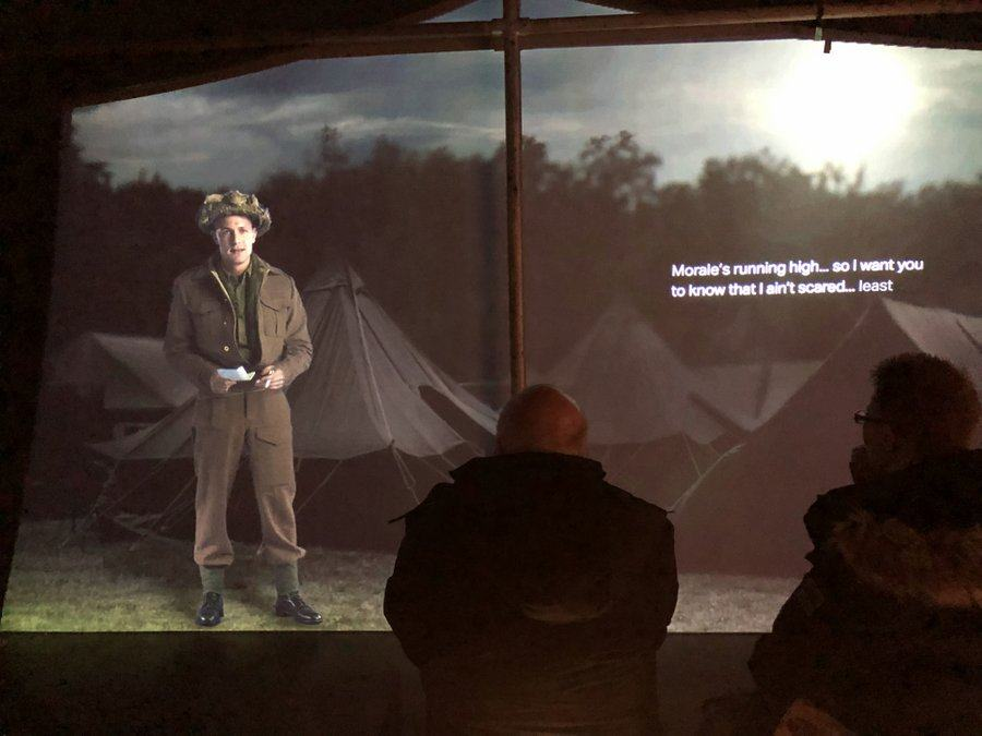 A screen presentation with a soldier talking about his experiences