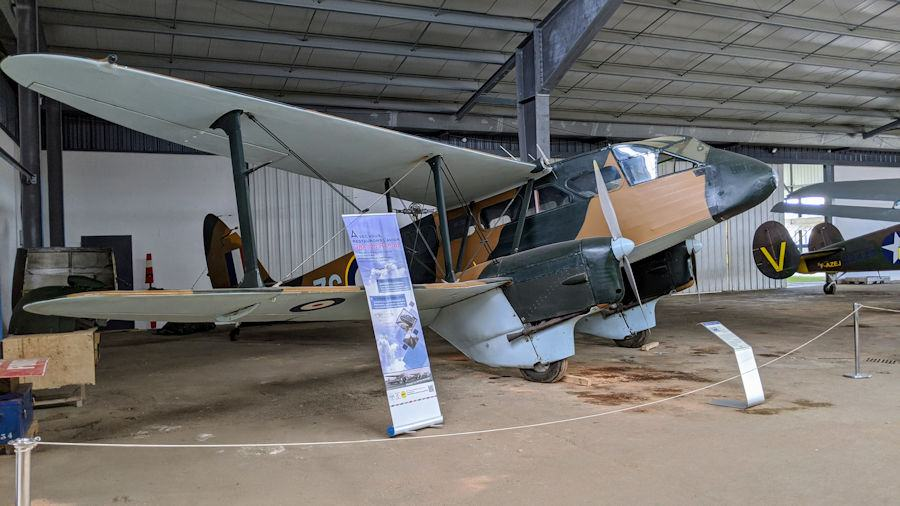 Twin engined passenger biplane in brown & green camouflage and with RAF roundels. On display at the Salis Flying Museum