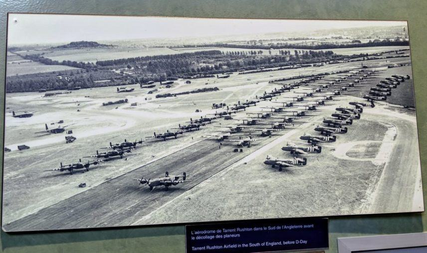 B&W aerial photo of an airfield full of planes and gliders