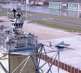 View of LCY's digital control tower in foreground with aircraft on the ground behind