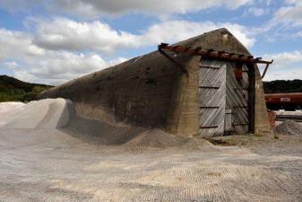 A long concrete bunker in a railway yard