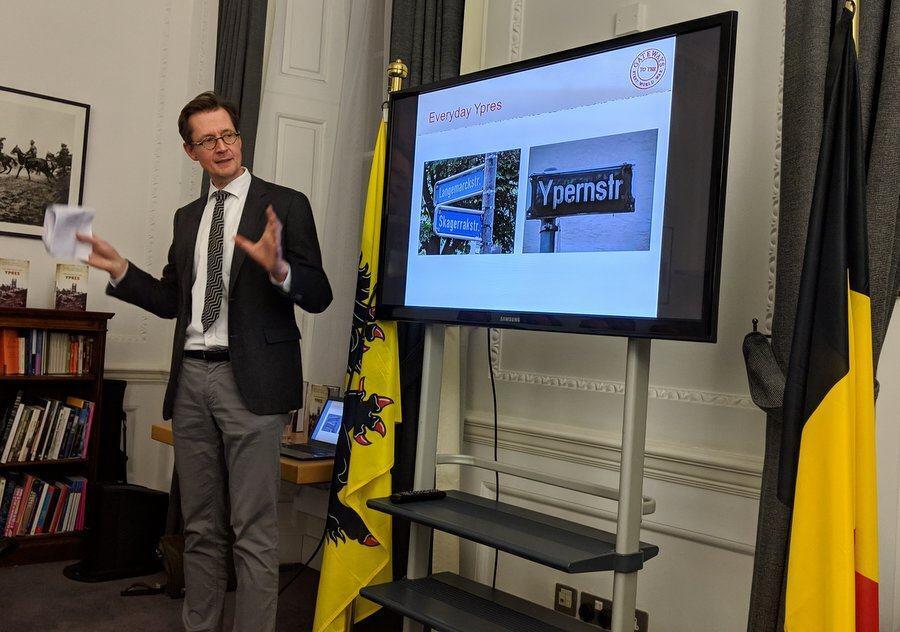 Dr Goebel speaking about a presentation slide on the screen beside him
