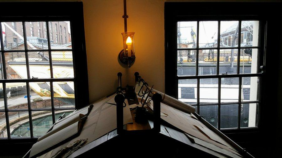 Drawing boards with SS Great Britain visible through window at Being Brunel museum