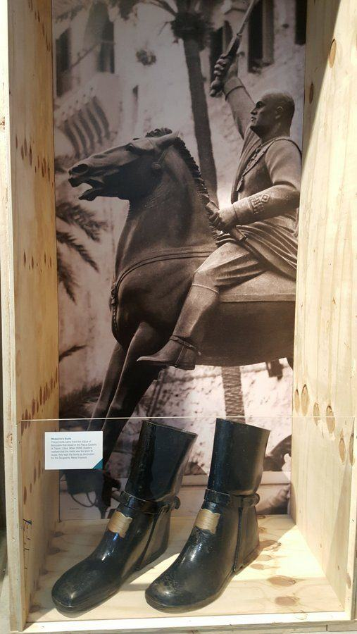 Mussolini's boots and a photo of the statue they came from