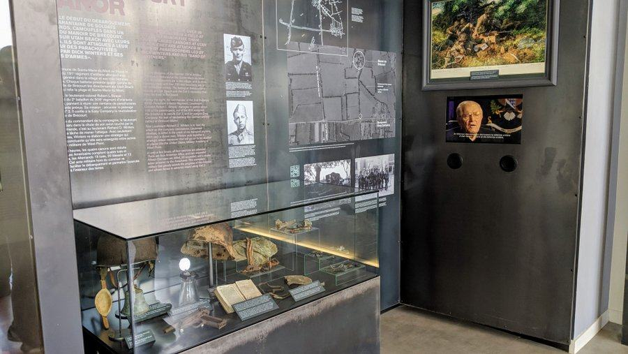 A display case, wall display and video screen featuring Lt. Dick Winter