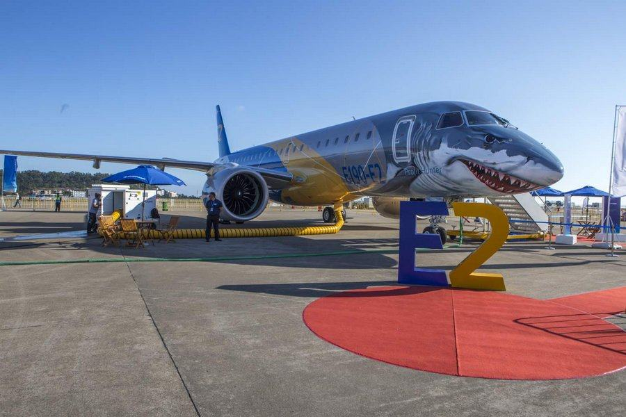 An Embraer aircraft on display on the tarmac. It has a shark face with sharp teeth.